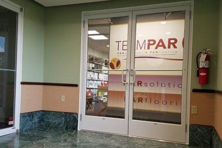 TeamPAR branding on wall behind office doors