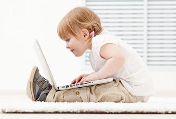 Child on laptop learning how to use WordPress