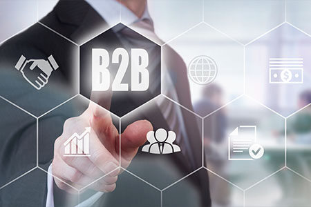 Businessman pressing a B2B branding concept button