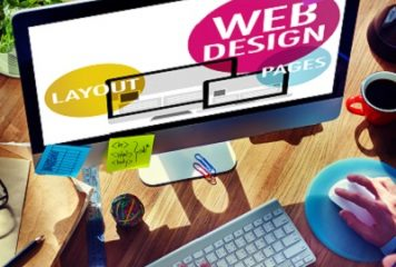Individual working on computer with the words web design, layout and pages appearing in bright colors