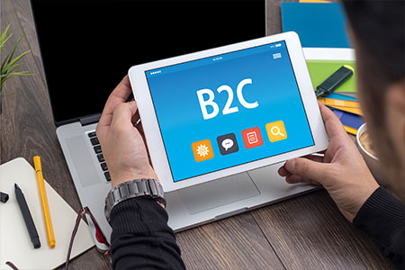 Tablet with B2C Marketing icons displayed on screen