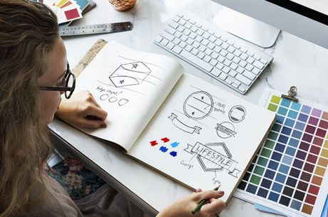 Woman sketching designs for a company rebranding