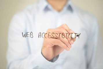 business man writing web accessibility on a screen