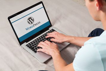 Laptop computer showing WordPress website on screen
