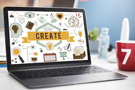 laptop displaying Create concept of website design