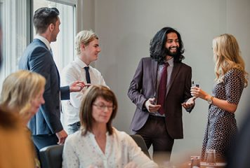 People chatting at a business event