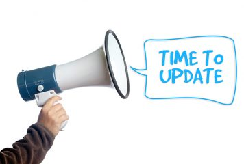 Arm holding a megaphone with words Time to Update showing