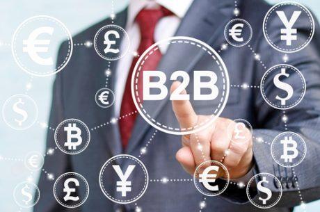 Businessman pressing B2B concept button on a virtual screen