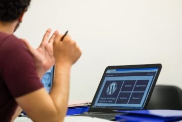 Person building a new wordpress site on a laptop