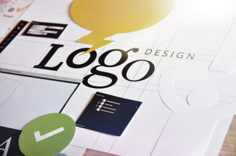 Logo design written on blueprints for various designs