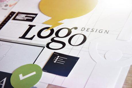 Logo design written on blueprints for various designs